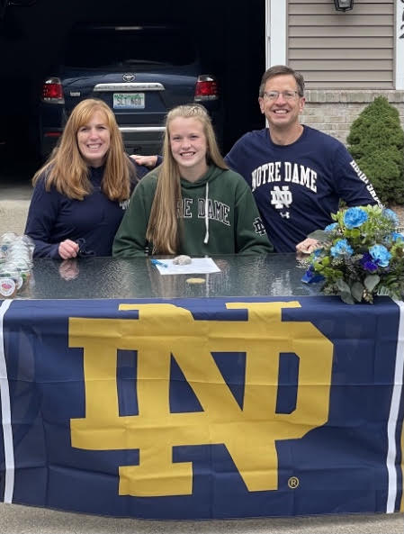 Natalie at signing celebration with her parents – University of Notre Dame - Indiana