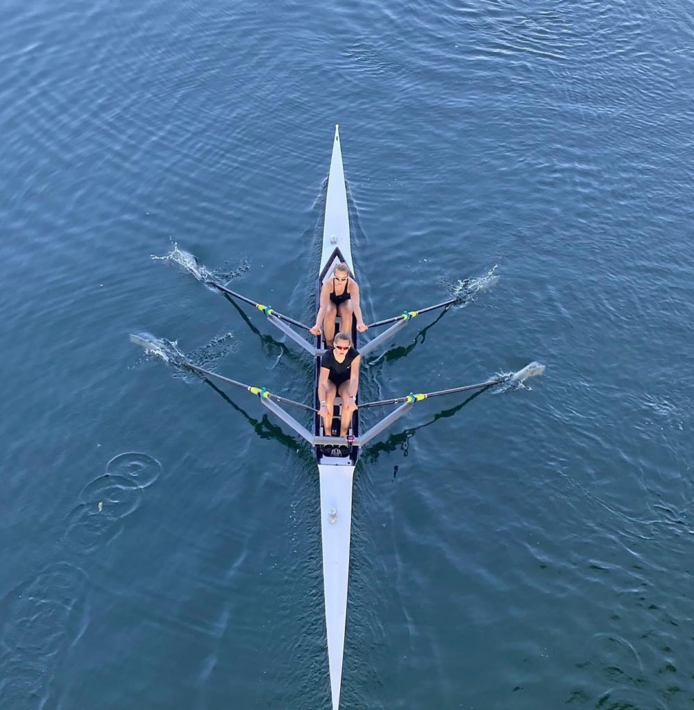 Anna rowing in the bow seat at the University of Texas.