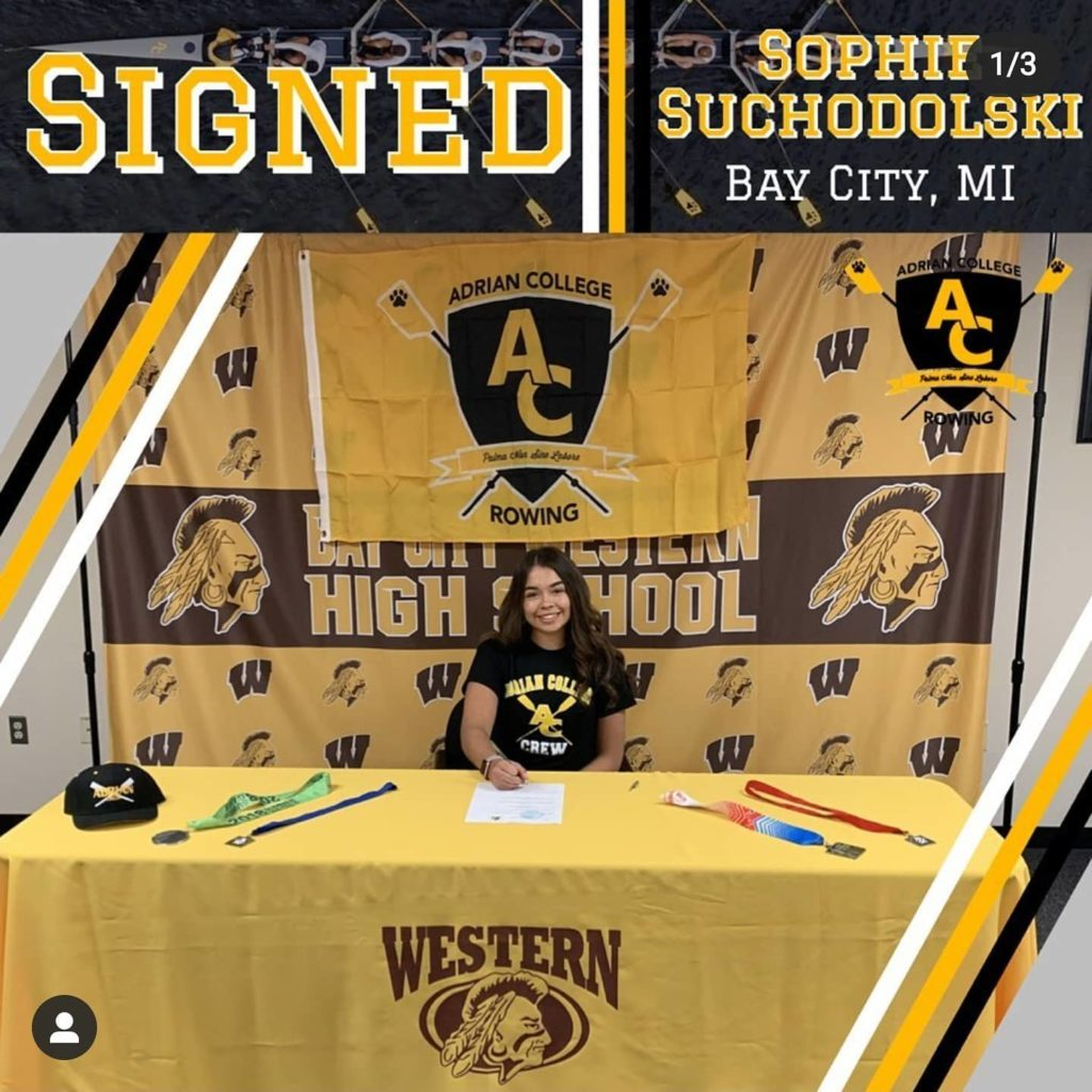 Sophie at signing celebration table at Bay City Western – Adrian College